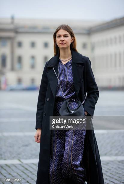 Jacqueline Zelwis is seen wearing Lala Berlin silk pants and top with print Gestuz coat in black Prada bag on November 27 2020 in Berlin Germany