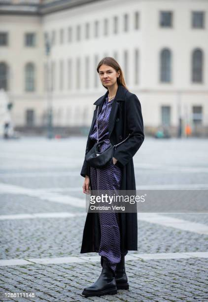 Jacqueline Zelwis is seen wearing Lala Berlin silk pants and top with print Gestuz coat in black Prada bag Toral boots on November 27 2020 in Berlin...