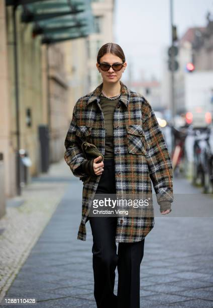 Jacqueline Zelwis is seen wearing Samsoe Samsoe checkered jacket Rabens Saloner shirt flared pants Lala Berlin AGL boots Fendi bag vintage olive...