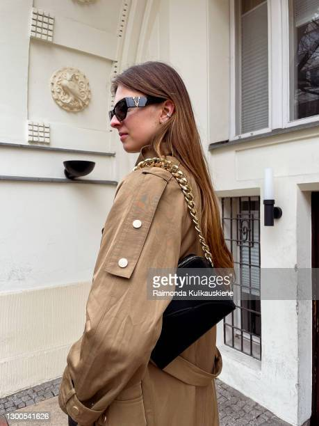 Jacqueline Zelwis wearing Copenhagen Muse coat, Holzweiler Shirt, Dante6 pants, Toral boots, ATP Atelier bag and Versace sunglasses poses during an...