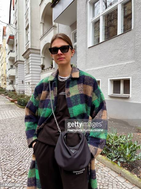 Jacqueline Zelwis wearing Munthe coat, ONWEEKENDS Jogger and Sweater, Nike sneakers, Prada bag, Saint Laurent sunglasses and Jewellery from Black...
