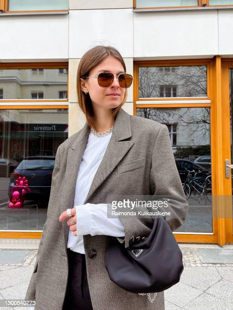 Jacqueline Zelwis wearing Muse for all Blazer, FFSS longsleeve, Brigitte Herskind pants, Balenciaga sneakers, Prada Bag and Prive Reveaux sunglasses...