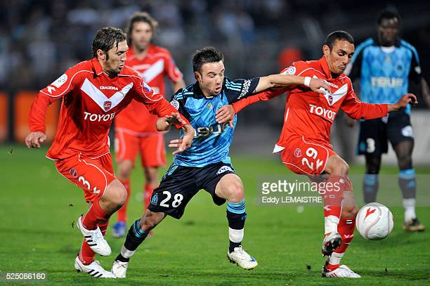 Jacques Abardonado Seid Khiter and Mathieu Valbuena during the French Ligue 1 soccer match between Valenciennes FC vs Olympique de Marseille