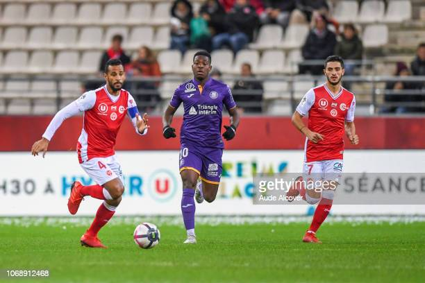 Jacques Alaixys Romao of Reims Aaron Leya Iseka of Toulouse and Xavier Chavalerin of Reims during the Ligue 1 match between Stade de Reims and...