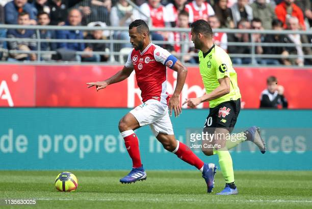 Jacques Alaixys Romao of Reims Thiago Maia of Lille during the French Ligue 1 match between Stade de Reims and Lille OSC at Stade Auguste Delaune on...