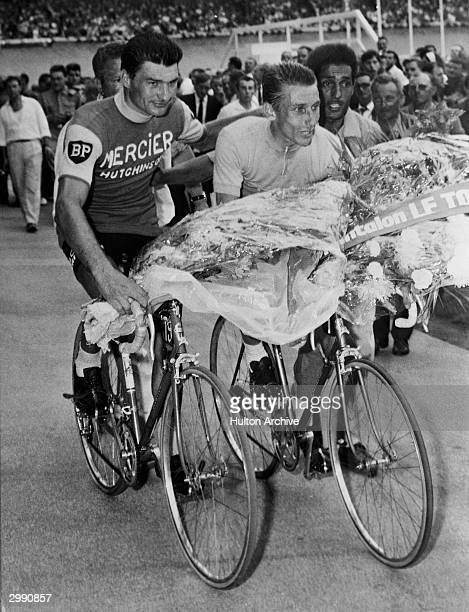 Jacques Anquetil wins the 1964 Tour de France for the fifth time is congratulated by second place winner Raymond Poulidor on July 151964 in Paris...