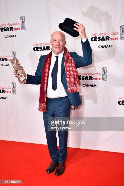 Jacques Audiard poses with the Cesar for Best Director award for the film 'Les Freres Sisters' during at Salle Pleyel on February 22 2019 in Paris...
