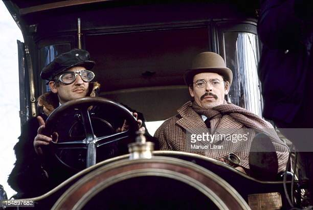 Jacques Brel sitting alongside Bruno CREMER driving a De DionBouton while filming a scene from the movie 'The Band Bonnot' Philippe FOURASTIE