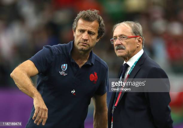 Jacques Brunel Head Coach of France and Assistant Coach Fabien Galthie look on prior to the Rugby World Cup 2019 Quarter Final match between Wales...