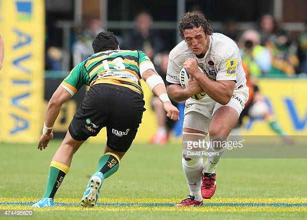 Jacques Burger of Saracens is tackled by George Pisi during the Aviva Premiership play off semi final match between Northampton Saints and Saracens...