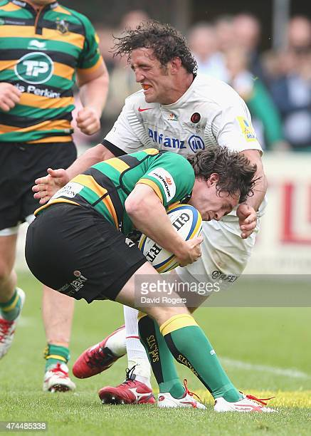 Jacques Burger of Saracens tackles Jamie Elliott during the Aviva Premiership play off semi final match between Northampton Saints and Saracens at...