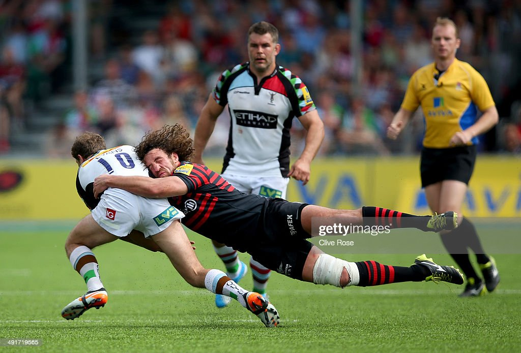 Jacques Burger of Saracens tackles Nick Evans of Harlequins during the Aviva Premiership Semi Final match between Saracens and Harlequins at Allianz Park on May 17, 2014 in Barnet, England.