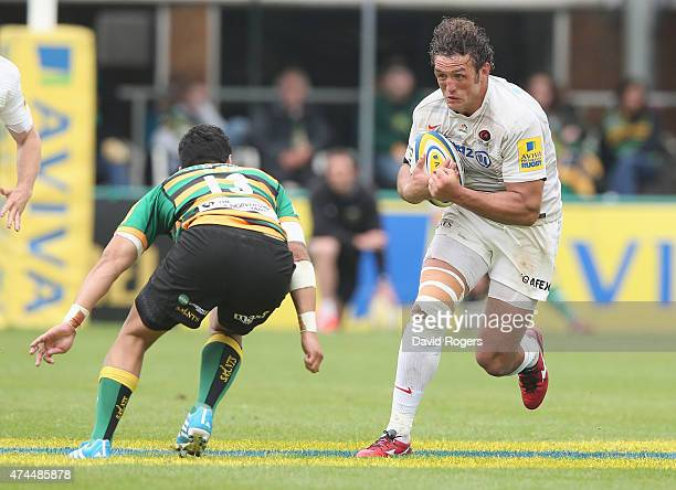 Jacques Burger of Saracens takes on George Pisi during the Aviva Premiership play off semi final match between Northampton Saints and Saracens at...