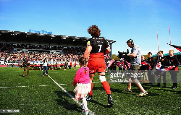 Jacques Burger of Saracens takes to the pitch with his children for his final match during the Aviva Premiership match between Saracens and Newcastle...