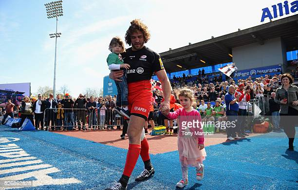 Jacques Burger of Saracens walks out with his children before the start of the Aviva Premiership match between Saracens and Newcastle Falcons at...