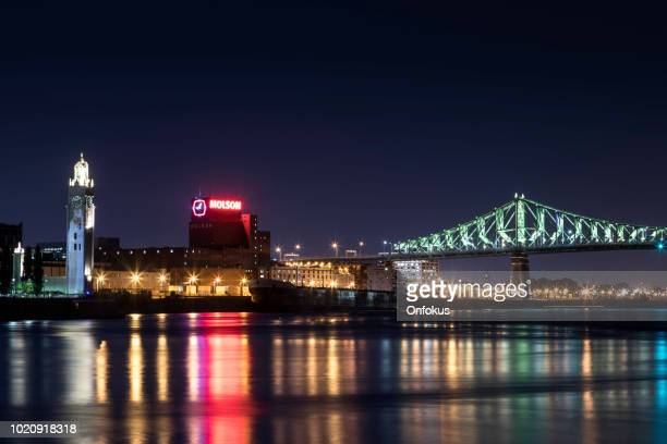 jacques cartier bridge illuminated at night, montreal, quebec - twilight stock pictures, royalty-free photos & images