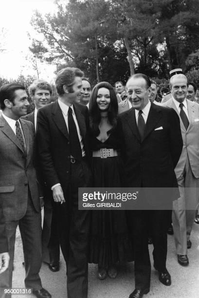 Jacques Chazot, Ludmilla Tcherina, André Malraux arrivent à la Fondation Maeght le 14 juillet 1973, à Saint Paul de Vence, France.