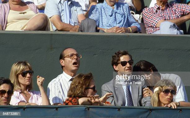 Jacques Chirac Nicolas Sarkozy and Claude Chirac the daughter of Jacques Chirac at the Roland Garros tennis tournament Paris June 1985