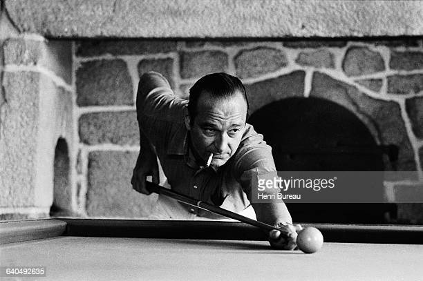 Jacques Chirac plays pool while on vacation in his Correze home. This pool table used to belong to President Georges Pompidou, and was offered to...