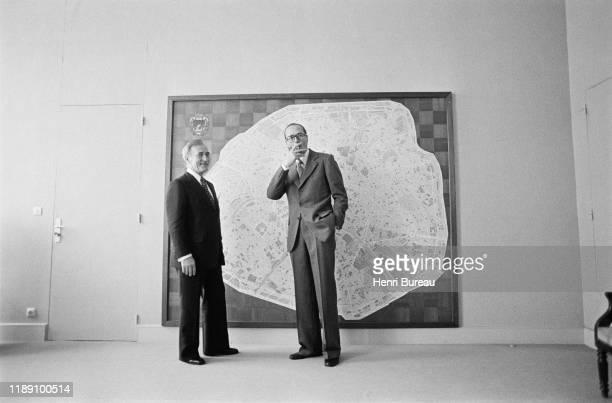 Jacques Chirac posing in front of a map of Paris, 25 March 1977