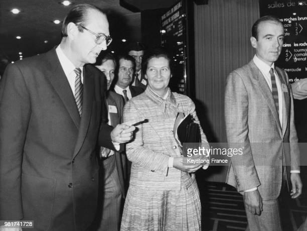 Jacques Chirac Simone Veil et Alain Juppé arrivant à l'hôtel PLM Saint Jacques pour l'anniversaire des clubs 89 à Paris en France le 10 octobre 1983