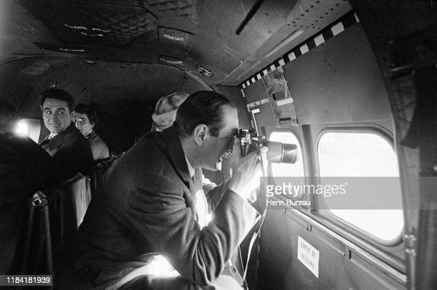 Jacques Chirac taking pictures on the flight to inaugurate a monument in honor of the former French president, Georges Pompidou in Saint Flour, 13th...