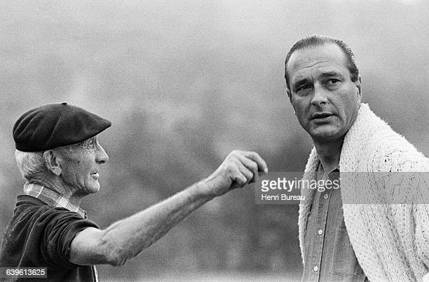 Jacques Chirac talking with a neighbor in the countryside of Correze.