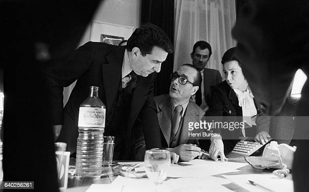Jacques Chirac talks to political advisors Pierre Juillet and MarieFrance Garraud at the RPR headquarters in rue de Lille