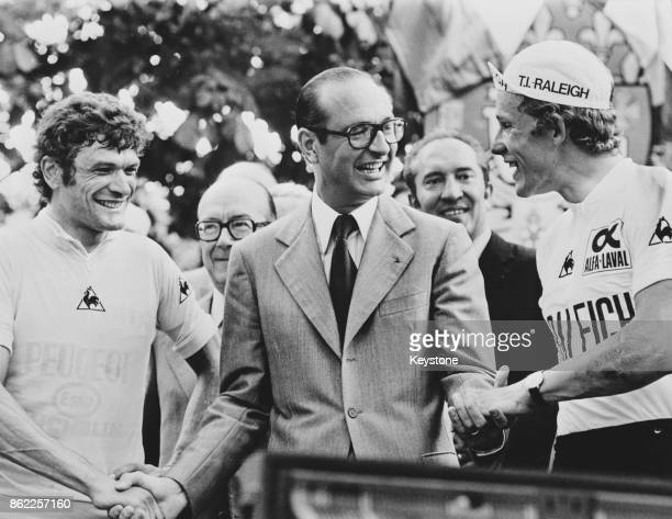 Jacques Chirac the Mayor of Paris congratulates Dietrich Thurau of Germany the winner of the Tour De France cycle race and runnerup Bernard Thévenet...