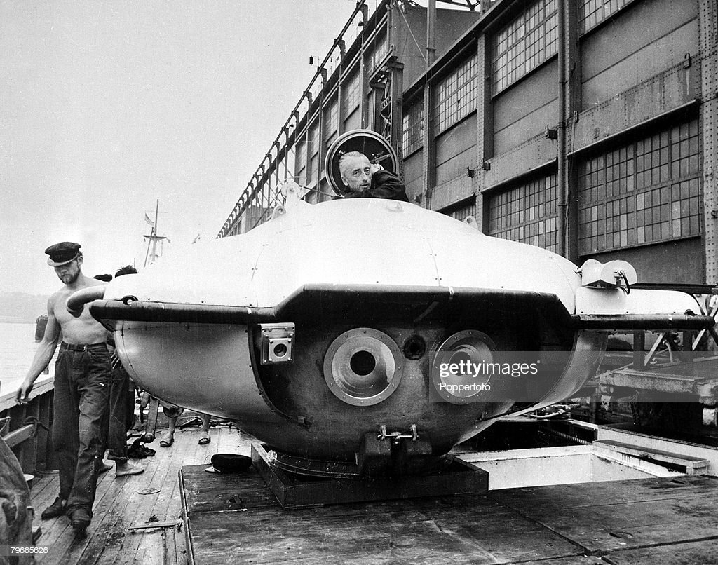 Jacques Cousteau the French undersea explorer stands by his bathyscaph 'Calypso' on a dockside in New York, USA, 1st September 1959