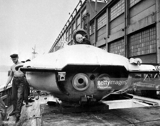 Jacques Cousteau the French undersea explorer stands by his bathyscaph 'Calypso' on a dockside in New York USA 1st September 1959