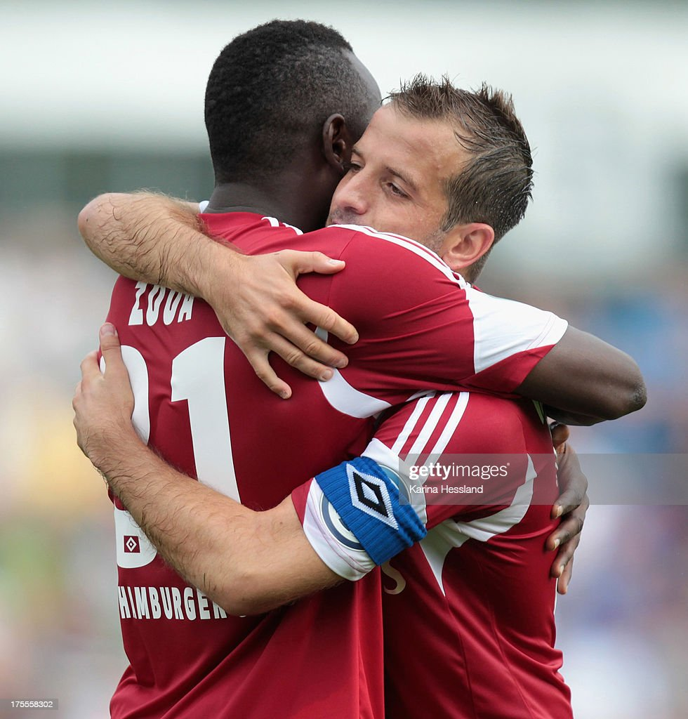Jacques Daogari Zoua and Rafael van der Vaart of Hamburg celebrate the third goal by Jacques Daogari Zoua during the DFB Cup between SV Schott Jena and Hamburger SV at Ernst-Abbe-Sportfeld on August 04, 2013 in Jena,Germany.