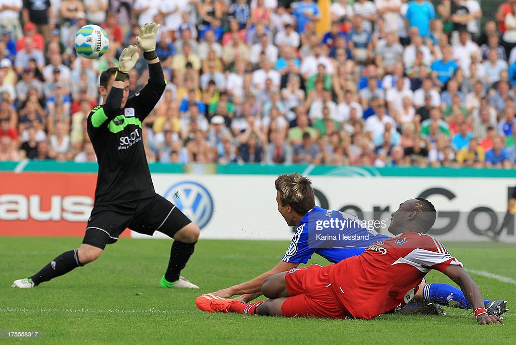 Jacques Daogari Zoua of Hamburg scores the third goal during the DFB Cup between SV Schott Jena and Hamburger SV at Ernst-Abbe-Sportfeld on August 04, 2013 in Jena,Germany.
