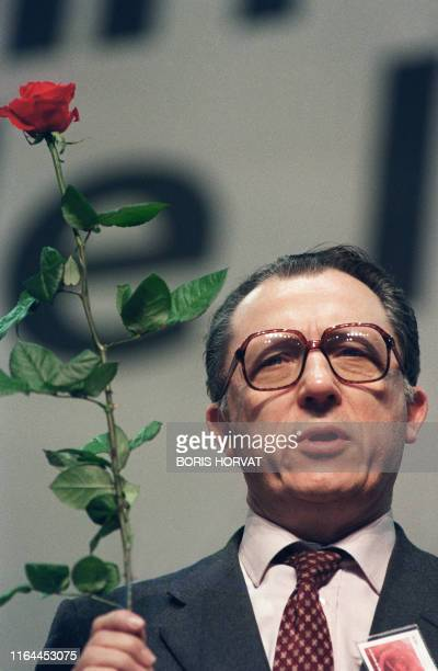 Jacques Delors President of the European Commission a red rose in his hand sings at the closing on April 5 1987 of the Congress of the French...