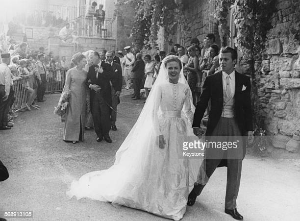Jacques d'Orleans son of the Duke and Duchess of Paris holding hands with his bride Gersende de SabanPonteves on their wedding day outside Ansouis...
