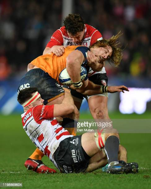 Jacques du Plessis of Montpellier is tackled by Lewis Ludlow and Val Rapava-Ruskin of Gloucester during the Heineken Champions Cup Round 5 match...