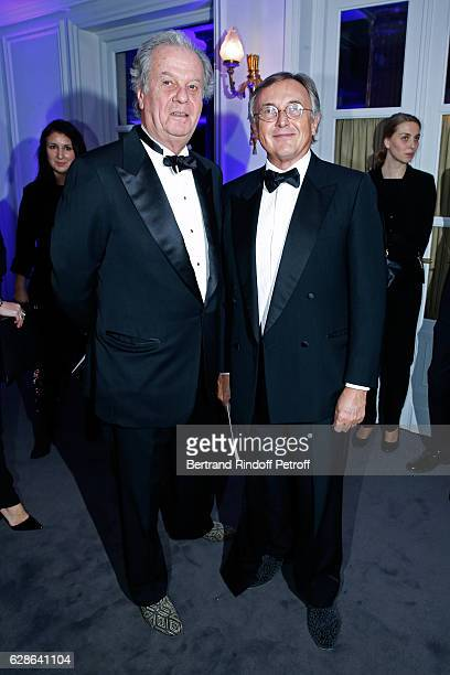 Jacques Grange and galerist Pierre Passebon attend the Annual Charity Dinner hosted by the AEM Association Children of the World for Rwanda at...