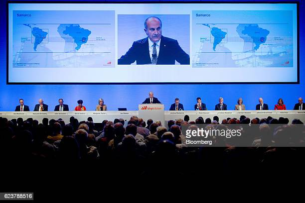 Jacques 'Jac' Nasser chairman of BHP Billiton Ltd center speaks as board members and executives look on during the company's annual general meeting...