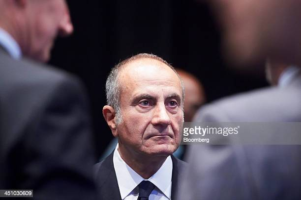 Jacques 'Jac' Nasser chairman of BHP Billiton Ltd speaks with fellow board members following the company's annual general meeting in Perth Australia...
