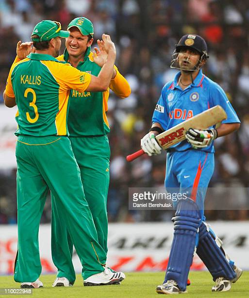 Jacques Kallis of South Africa celebrates with team mate Graeme Smith after taking the catch to dismiss Gautam Gambhir of India during the Group B...