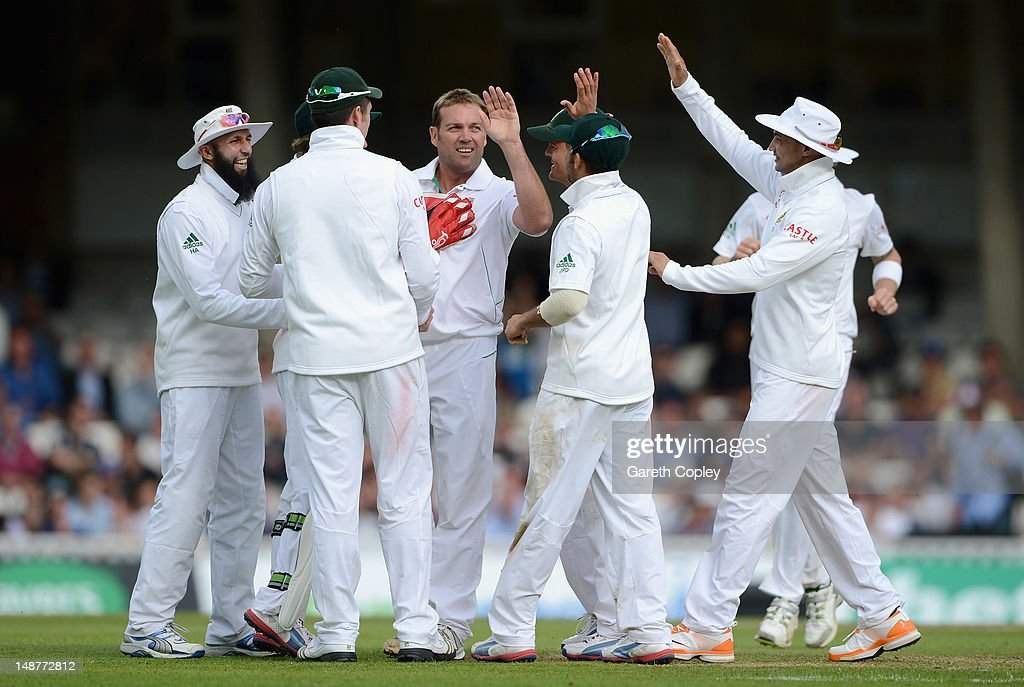 Jacques Kallis of South Africa celebrates with team-mates after dismissing Kevin Pietersen of England during day one of the 1st Investec Test match between England and South Africa at The Kia Oval on July 19, 2012 in London, England.