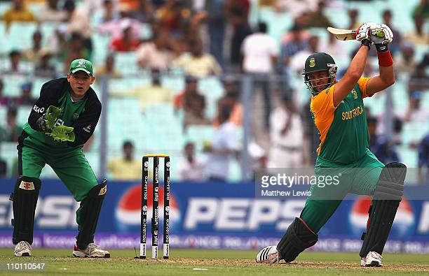 Jacques Kallis of South Africa hits the ball towards the boundary as Niall O'Brien of Ireland looks on during the 2011 ICC World Cup Group B match...
