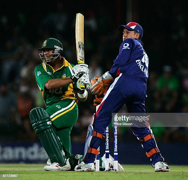 Jacques Kallis of South Africa in action watched by Geraint Jones of England during the second one day international match between South Africa and...