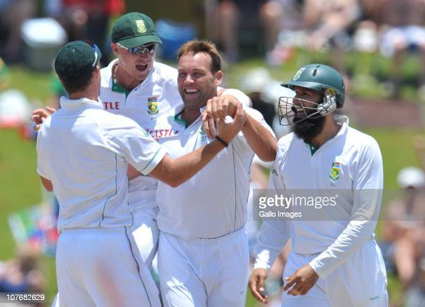 Jacques Kallis of South Africa is congratulated after capturing the wicket of Suresh Raina during day 4 of the 1st Test match between South Africa...