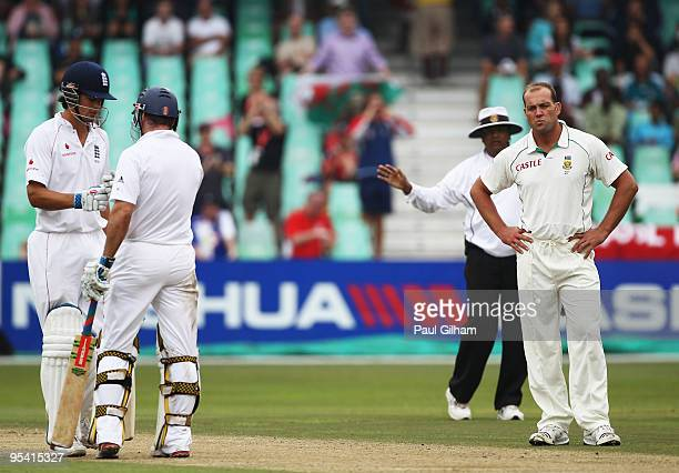 Jacques Kallis of South Africa looks frustrated as Andrew Strauss of England celebrates with Alastair Cook after hitting a boundary for four runs...