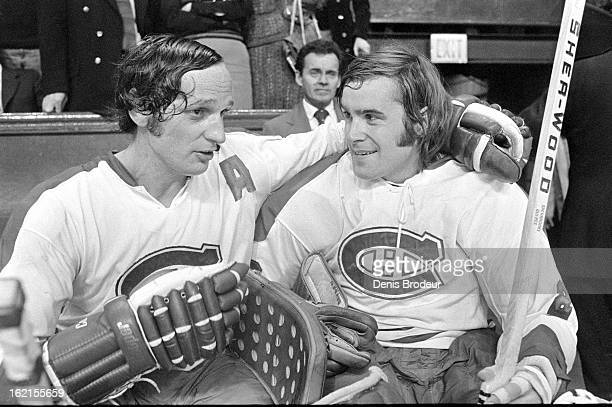 Jacques Laparriere and Ken Dryden of the Montreal Canadiens have a conversation on the bench during a game at the Montreal Forum circa 1972 in...