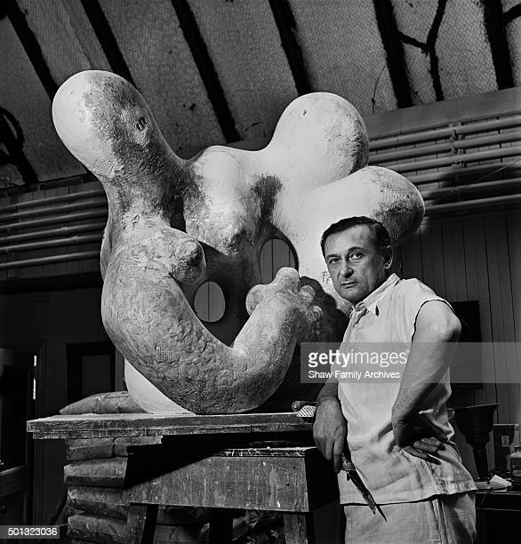 Jacques Lipchitz stands in front of his sculpture Benediction I in 1944