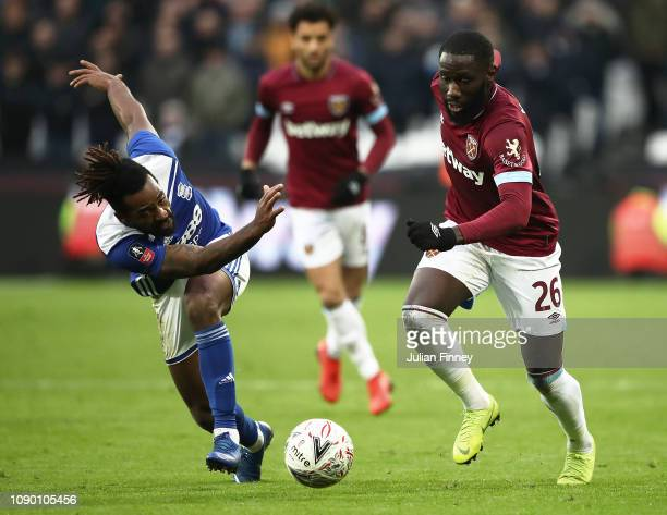 Jacques Maghoma of Birmingham City is challenged by Arthur Masuaku of West Ham United during the FA Cup Third Round match between West Ham United and...