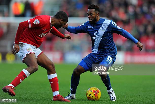 Jacques Maghoma of Birmingham City is tackled by Mark Little of Bristol City during the Sky Bet Championship match between Bristol City and...