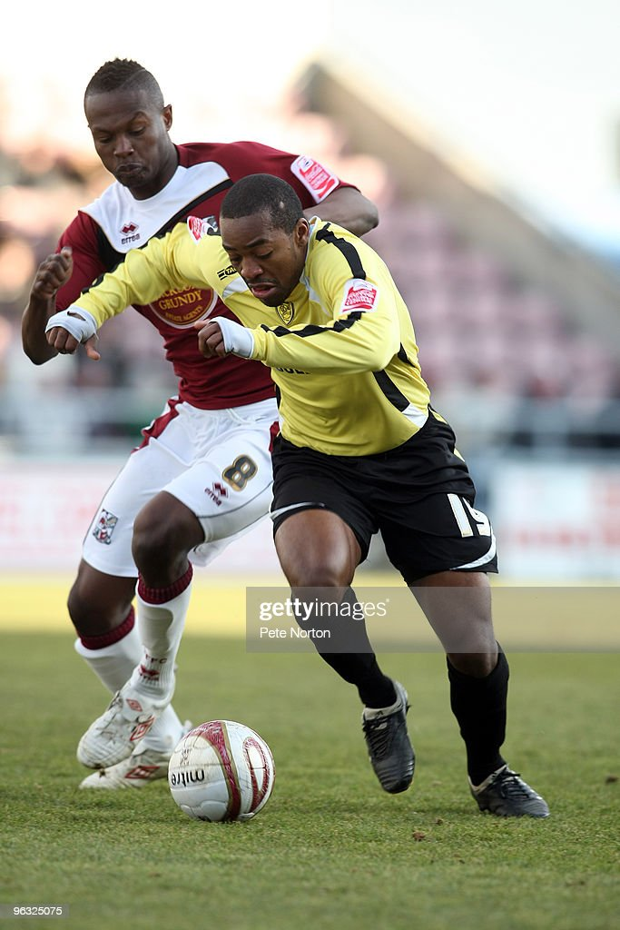 Jacques Maghoma of Burton Albion attempts to move away from Abdul Osman of Northampton Town during the Coca Cola League Two Match between 30, 2010 in Northampton, England.